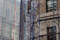 Netting and scaffolding protect passer-by during restoration and repair work on the facades of two buildings in the Flatiron neighborhood in New York on Friday, May 25, 2012.  (© Richard B. Levine)