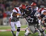 Ole Miss defensive tackle Jerrell Powe (57) tackles Louisiana-Lafayette's Robert Walker (6)  in Oxford, Miss. on Saturday, November 6, 2010. Ole Miss won 43-21.