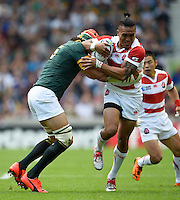 Male Sa'u of Japan takes on the South Africa denfece. Rugby World Cup Pool B match between South Africa and Japan on September 19, 2015 at the Brighton Community Stadium in Brighton, England. Photo by: Patrick Khachfe / Onside Images