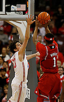 Ohio State Buckeyes guard Amedeo Della Valle (33)goes for the block against Nebraska Cornhuskers guard Deverell Biggs (1) at Value City Arena in Columbus Jan. 4, 2013 (Dispatch photo by Eric Albrecht)