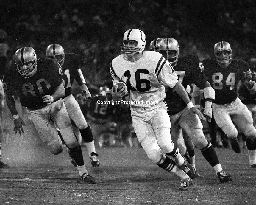 Oakland Raiders vs. Baltimore Colts , Raiders #80 Art Thoms, Harold Rice, and Tony Cline chase Colt quarterback..(1971 pre-season?)<br />(photo/Ron Riesterer)