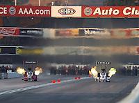 Nov 12, 2016; Pomona, CA, USA; NHRA top fuel driver Shawn Reed (left) alongside Richie Crampton during qualifying for the Auto Club Finals at Auto Club Raceway at Pomona. Mandatory Credit: Mark J. Rebilas-USA TODAY Sports