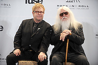 Elton John and Leon Russell at the 26th annual Rock and Roll Hall of Fame Induction Ceremony at The Waldorf=Astoria  in New York City. March 14, 2011. Credit: Dennis Van Tine/MediaPunch