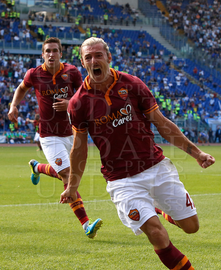 Calcio, Serie A: Roma vs Lazio. Roma, stadio Olimpico, 22 settembre 2013.<br /> AS Roma defender Federico Balzaretti celebrates after scoring during the Italian Serie A football match between AS Roma and Lazio, at Rome's Olympic stadium, 22 September 2013.<br /> UPDATE IMAGES PRESS/Riccardo De Luca