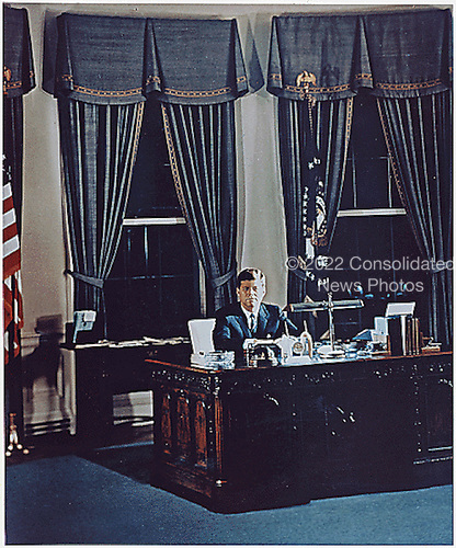Portrait of United States President John F. Kennedy at his desk in the Oval Office of the White House in Washington, DC on November 2, 1961.<br /> Credit: Robert Knudsen / White House via CNP