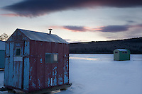 Ice fishing shacks on Eagle Lake,  Acadia National Park, await their intrepid  occupants. The park is a meeting place for sportsman and helps support traditional activities. It's a typical midwinter morning in downeast Maine with the temperature at 1 degree F and a wind chill of -15F.