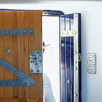 A double wood and steel door heralds the entrance to the property