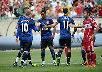 Manchester United forward Wayne Rooney (10) is congratulated by Nani (17, center) after scoring Manchester United's first goal.  Manchester United defeated the Chicago Fire 3-1 at Soldier Field in Chicago, IL on July 23, 2011.