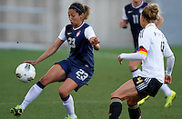 US's Christen Press fights for the ball with Germany's Babett Peter during their Algarve Women's Cup soccer match at Algarve stadium in Faro, March 13, 2013.  .Paulo Cordeiro/ISI