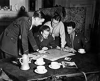 Jedburghs get instructions from Briefing Officer in London flat.  England, ca.  1944. (OSS)<br /> Exact Date Shot Unknown<br /> NARA FILE #:  226-FPL-MH-109<br /> WAR &amp; CONFLICT BOOK #:  1037