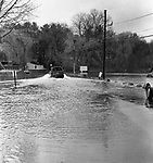A vehicle makes its way across the flooded causeway to Deer Island on Bantam Lake in Morris, 1987.