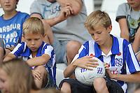 VOETBAL: HEERENVEEN: Abe Lenstra Stadion, 07-07-2012, Open Dag, Jonge supporter bekijkt zijn bal met handtekeningen tijdens de Open Dag van SC Heerenveen, ©foto Martin de Jong