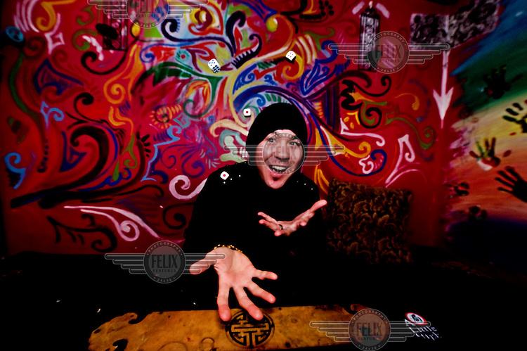 Dj Chozie throws dice at a nightclub.