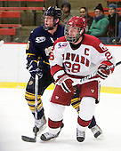 ?, Chris Huxley (Harvard - 28) - The visiting Quinnipiac University Bobcats defeated the Harvard University Crimson 3-1 on Wednesday, December 8, 2010, at Bright Hockey Center in Cambridge, Massachusetts.