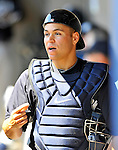 12 March 2011: New York Yankees' catcher Russell Martin walks down the dugout during a Spring Training game against the Washington Nationals at Space Coast Stadium in Viera, Florida. The Nationals edged out the Yankees 6-5 in Grapefruit League action. Mandatory Credit: Ed Wolfstein Photo