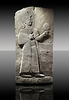 Picture & image of a Neo-Hittite orthostat showing a releif sculpture  of the Goddess Kubaba from Karkamis,, Turkey. Ancora Archaeological Museum. 3 In her right hand she is holding a pomegranate