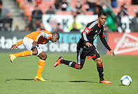 Luis Silva (12) of D.C. United goes against Boniek Garcia (27) of the Houston Dynamo. The Houston Dynamo defeated D.C. United 2-1, at RFK Stadium, Saturday October 27, 2013.