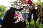 Parishioners mingle with their pets after a special Blessing of the Pets service at the Los Altos Lutheran Church.