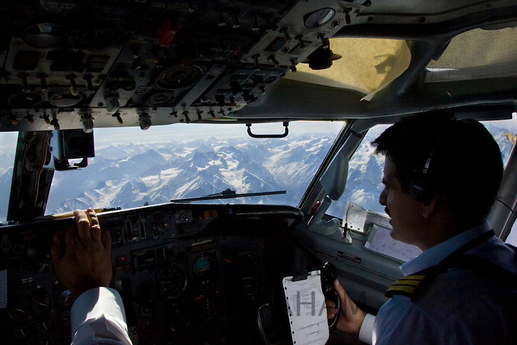 Pilots flying 737 jet airplane over Karokoram mountains above Skardu Valley in Northern Pakistan