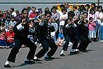 Boys demostrating their Judo/Karate moves at the downtown park in ChinaTown with a large crowd watching Seattle, Washington State USA