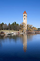 WA11236-00...WASHINGTON - The clock tower reflecting on the Spokane River along Riverfront Park in Spokane.