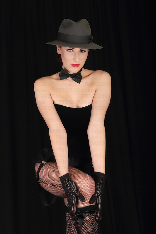 Beautiful young woman, posing like an actress in cabaret show!