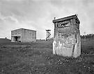 Guard towers and massive concrete plutonium storage bunker