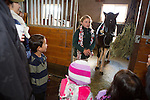 A pony club member demonstrates horse grooming to guests at the Annual Holiday Barn Lighting at Westwind Barn in Los Altos Hills Dec. 2.