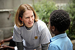 Beth Frank, a program monitoring and evaluation specialist for Church World Service, talks with a young refugee in Cairo, Egypt. The children attend a school operated by St. Andrew's Refugee Services, which is supported by Church World Service.