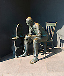 Washington DC; USA: The Franklin Delano Roosevelt Memorial. Sculpture of a man listening to a Fireside Chat.  .Photo copyright Lee Foster Photo # 14-washdc83199