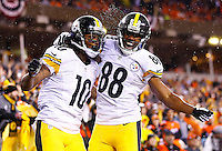 Martavis Bryant #10 of the Pittsburgh Steelers celebrates with teammate Darrius Heyward-Bey #88 following his touchdown in the second half during the Wild Card playoff game at Paul Brown Stadium on January 9, 2016 in Cincinnati, Ohio. (Photo by Jared Wickerham/DKPittsburghSports)