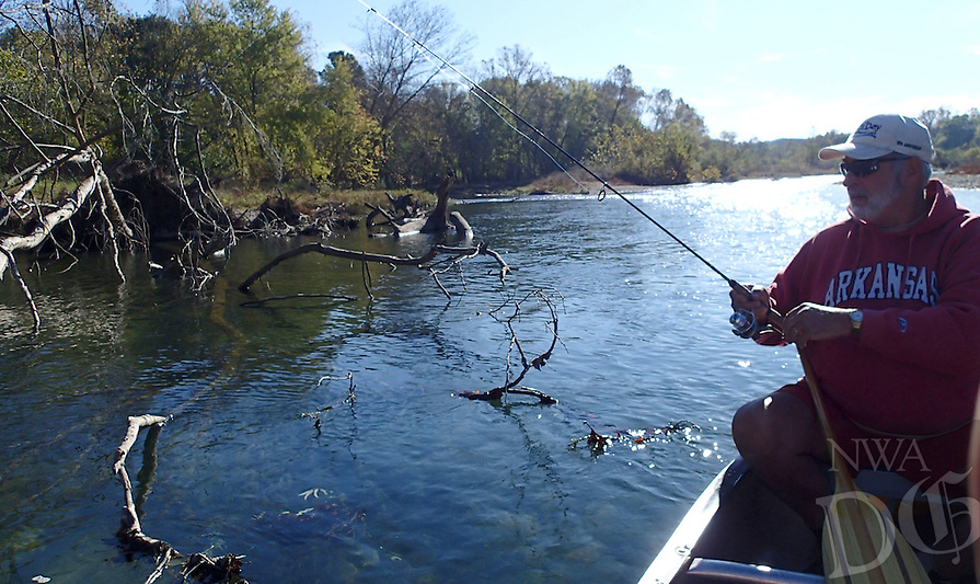 NWA Democrat-Gazette/FLIP PUTTHOFF <br /> Ross probes the timber    Nov. 11 2016   in search of smallmouth bass.
