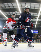 Erik Gudbranson (Canada - 5), Kenny Ryan (US - 26) - The US defeated Canada 2-1 at the Urban Plains Center in Fargo, North Dakota, on Friday, April 17, 2009, in their semi-final match during the 2009 World Under 18 Championship.