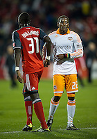 07 May 2011: Houston Dynamo midfielder Lovel Palmer #22 shakes hands at the end of the game with Toronto FC defender Dicoy Williams #31 during an MLS game between the Houston Dynamo and the Toronto FC at BMO Field in Toronto, Ontario..Toronto FC won 2-1.