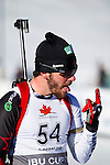 Canadian Marc-Andre Bedard celebrates after crossing the finish line at The International Biathlon Union Cup # 7 Men's 10 KM Sprint held at the Canmore Nordic Center in Canmore Alberta, Canada, on Feb 16, 2012.  Marc-Andre takes 5th place in the sprint.  Photo by Gus Curtis