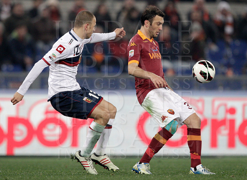 Calcio, Serie A: Roma vs Genoa. Roma, stadio Olimpico, 3 marzo 2013..AS Roma defender Vasilis Torosidis, of Greece, right, is challenged by Genoa defender Luca Antonelli during the Italian Serie A football match between AS Roma and Genoa at Rome's Olympic stadium, 3 March 2013..UPDATE IMAGES PRESS/Riccardo De Luca