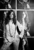 Janis Joplin at home with Bob Seidemann poster, Haight-Ashbury, San Francisco, November 1967<br /> Photo Credit: Baron Wolman\AtlasIcons.com