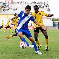 Kemo Wallace (3) of Jamaica tries to stop Hristopher Robles (9) of Guatemala during the group stage of the CONCACAF Men's Under 17 Championship at Catherine Hall Stadium in Montego Bay, Jamaica. Jamaica defeated Guatemala, 1-0.