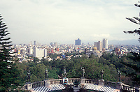 View of Ninos Heroes statues and Mexico City skyline from Chapultepec Castle