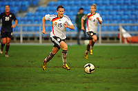 German defender Sonja Fuss chases down the ball.  The USA captured the 2010 Algarve Cup title by defeating Germany 3-2, at Estadio Algarve on March 3, 2010.