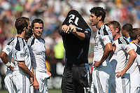 Los Angeles Galaxy goalkeeper Josh Saunders (12) removes his jersey for Los Angeles Galaxy forward Mike Magee (18, far left) after being ejected from game. The San Jose Earthquakes tied the Los Angeles Galaxy 0-0 at Buck Shaw Stadium in Santa Clara, California on June 25th, 2011.
