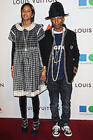 LOS ANGELES, CA, USA - MARCH 29: Helen Lasichanh, Pharrell Williams at the MOCA's 35th Anniversary Gala Presented By Louis Vuitton held at The Geffen Contemporary at MOCA on March 29, 2014 in Los Angeles, California, United States. (Photo by Celebrity Monitor)