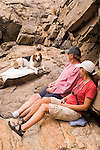 Hikers and dog taking a break from the trail, near Canyon Creek, Tahoe National Forest California