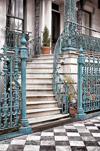 Decorative wrought iron staircase in Charleston, SC. These marble steps predate the American Civil War along with the original checkered marble sidewalk.