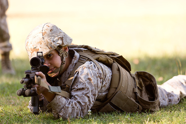 October 22, 2014. Camp LeJeune, North Carolina.<br />  Cpl. Raquel Mathieu takes aim with a M27 Infantry Automatic Rifle during patrol training for the 3rd Platoon of the Ground Combat Element Integrated Task Force. Marines in 3rd Platoon of the GCEITF are all considered provisional infantrymen as they have not been to the School of Infantry (SOI) previous to volunteering for the GCEITF.<br />  The Ground Combat Element Integrated Task Force is a battalion level unit created in an effort to assess Marines in a series of physical and medical tests to establish baseline standards as the Corps analyze the best way to possibly integrate female Marines into combat arms occupational specialities, such as infantry personnel, for which they were previously not eligible. The unit will be comprised of approx. 650 Marines in total, with about 400 of those being volunteers, both male and female. <br />  Jeremy M. Lange for the Wall Street Journal<br /> COED
