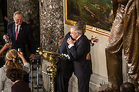 President Barack Obama hugs House Majority Leader Harry Reid (D-NV) at the Inaugural Luncheon in Statuary Hall at the U.S. Capitol on Monday, January 21, 2013 in Washington, DC.