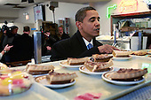 Chicago, Il - November 21, 2008 -- United States President-elect Barack Obama checks out the pie offerings at Manny's Coffee Shop and Deli during a lunch break from his transition office at the federal building Friday, November 21, 2008 in Chicago, Illinois. Obama ordered a corned beef sandwich and greeted customers before leaving the restaurant. .Credit: Scott Olson - Pool via CNP