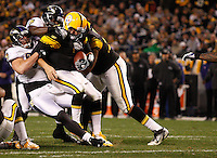 PITTSBURGH, PA - NOVEMBER 06:  Ben Roethlisberger #7 of the Pittsburgh Steelers is sacked by members of the Baltimore Ravens during the game on November 6, 2011 at Heinz Field in Pittsburgh, Pennsylvania.  (Photo by Jared Wickerham/Getty Images)