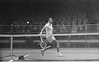 American tennis player Pancho Gonzales in action vs Australian Lew Hoad, Madison Square Garden, 2/58. Photograph by John G. Zimmerman.