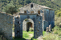 Ruins of Skordilis Mansion house and archway in oldest town in Corfu - ancient village of Old Perithia, - Palea Peritheia, Greece